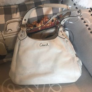 Ivory well loved and used Coach purse.